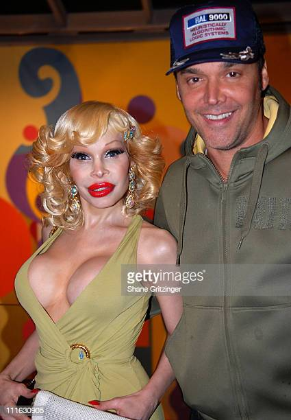 Amanda Lepore and David LaChapelle during David LaChapelle Signs His New Book 'Heaven to Hell' at the Taschen Store Soho in New York City February 22...