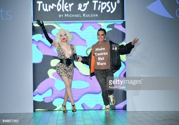Amanda Lepore and Michael Kuluva walk the runway at the Tumbler and Tipsy by Michael Kuluva fashion show at Metropolitan West on September 13 2017 in...