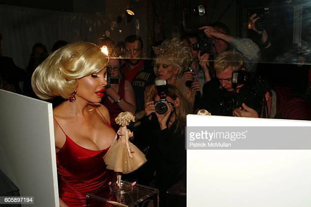 Amanda Lepore and Paparazzi attends AMANDA LEPORE DOLL cocktail party at Jeffrey on April 11 2006 in New York City