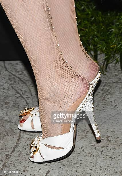 Amanda Lepore heels detail attends the Kiehl's Pure Vitality Launch Party at Bleecker Event Hall on January 5 2017 in New York City