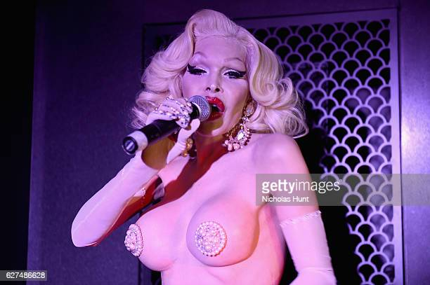 Amanda Lepore performs at the August Getty 305 cocktail party with hosts August Getty and Susanne Bartsch at Saxony Bar at the Faena Hotel on...