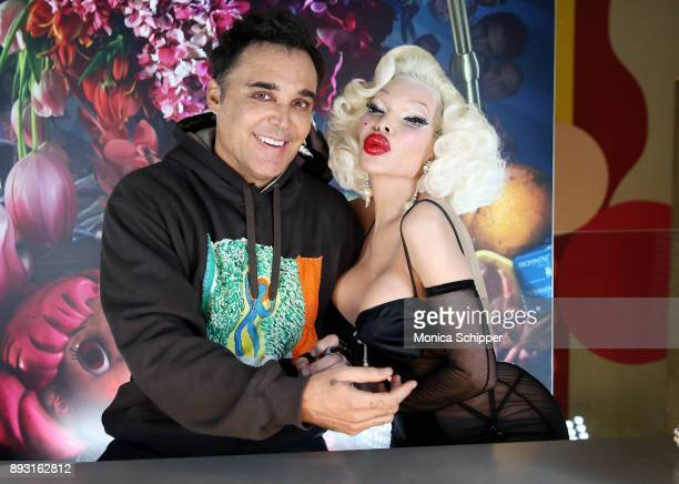 Amanda Lepore poses for a photo with photographer David LaChapelle when he signs copies of his new doublevolume book 'Good News Part I' And 'Lost...
