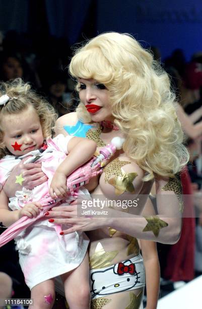 Amanda Lepore with child during Heatherette Fashion Show at The Lot @ The Standard Hotel Downtown in Los Angeles CA United States