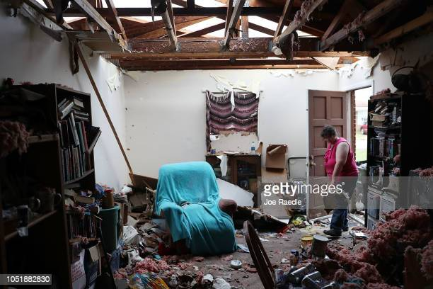 Amanda Logsdon begins the process of trying to clean up her home after the roof was blown off by the passing winds of hurricane Michael on October 11...