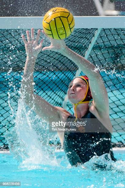 Amanda Longan of the University of Southern California blocks a Stanford University shot attempt during the Division I Women's Water Polo...