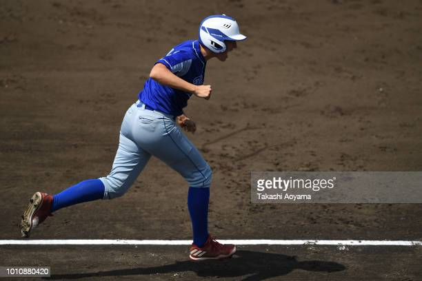 Amanda Lynn Fama of Italy celebrates as she rounds the bases after hitting a solo home run in the first inning against Australia during the...