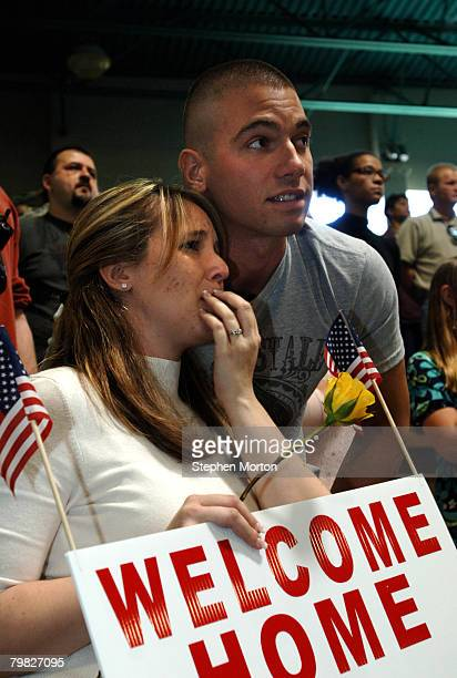 Amanda Machesky and her brother in law Caleb Machesky of Pittsburgh Pa look for Spc Adam Machesky in a group of soldiers with the US Army's 293rd...