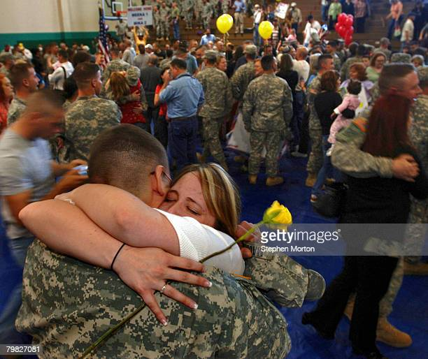 Amanda Machesky hugs her husband Spc Adam Machesky with the US Army's 293rd Military Police Company during a homecoming ceremony February 18 2008 in...