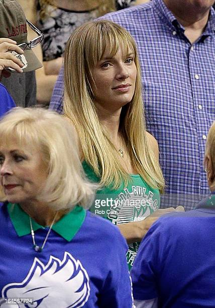 Amanda Marcum the wife of head coach Andy Enfield of the Florida Gulf Coast Eagles watches in the first half against the San Diego State Aztecs...