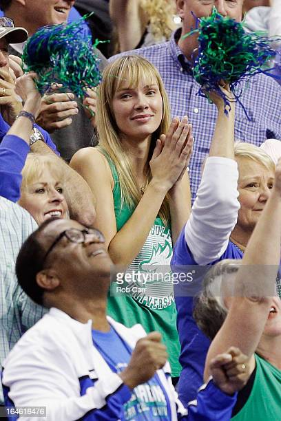 Amanda Marcum the wife of head coach Andy Enfield of the Florida Gulf Coast Eagles watches in the second half against the San Diego State Aztecs...