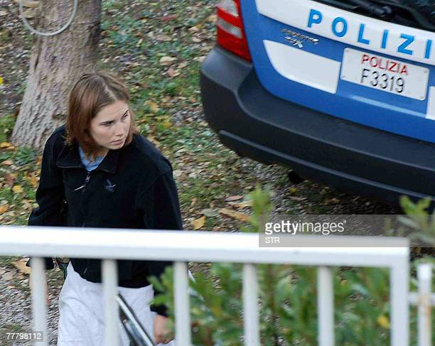 Amanda Marie Knox, under investigation for the murder of British exchange student Meredith Kercher, is pictured outside her home in Perugia, 05...