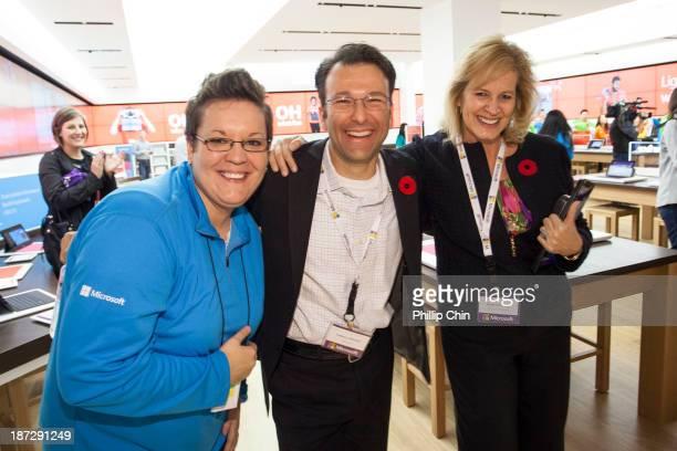 Amanda Matheis Microsoft Store Manager Judson Althoff President of Microsoft North America and Janet Kennedy President of Microsoft Canada celebrate...