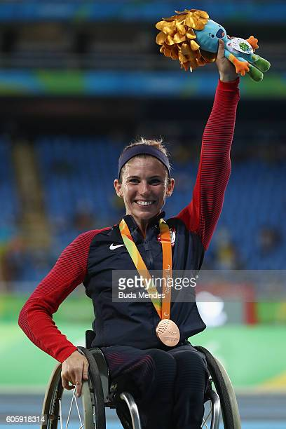 Amanda McGrory of the United States celebrate winning the bronze medal in the Women's 5000m T54 Final on day 8 of the Rio 2016 Paralympic Games at...