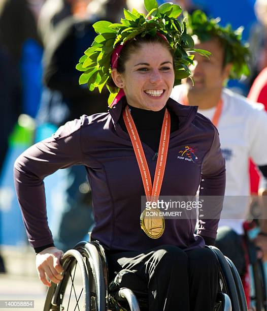 Amanda McGrory of the US smiles after winning the women's wheelchair division of the ING New York City Marathon November 6 2011 in New York AFP...