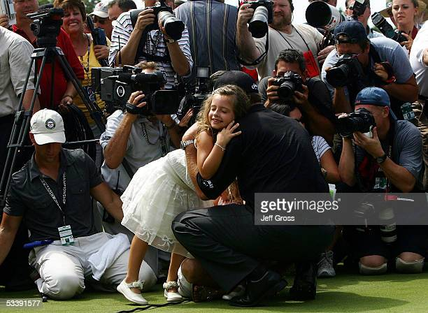 Amanda Mickelson hugs her father Phil Mickelson in front of a mass of photographers after Phil won the 2005 PGA Championship on August 15 2005 in...