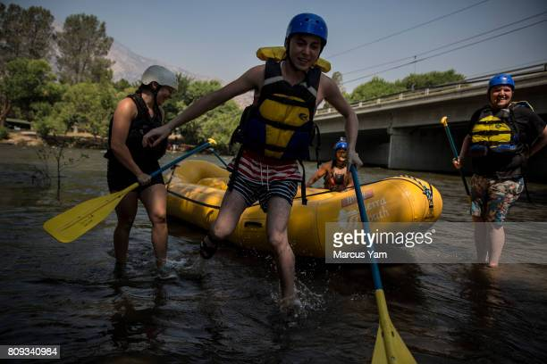 Amanda Moreno from Lake Isabella Matthew Hansen from Los Angeles Aaron Lafarga river guide and Tyler Barnett from Los Angeles complete a rafting trip...
