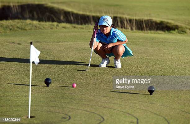 Amanda Nguyen lines up her putt during the Drive Chip and Putt regional qualifying at Chambers Bay on September 12 2015 in University Place Washington