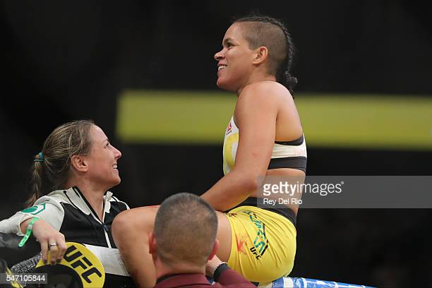 Amanda Nunes celebrates his victory over Miesha Tate during the UFC 200 event at TMobile Arena on July 9 2016 in Las Vegas Nevada
