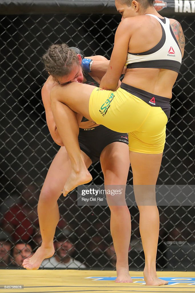 Amanda Nunes knees Miesha Tate during the UFC 200 event at T-Mobile Arena on July 9, 2016 in Las Vegas, Nevada.