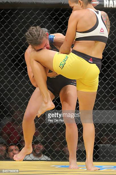 Amanda Nunes knees Miesha Tate during the UFC 200 event at TMobile Arena on July 9 2016 in Las Vegas Nevada