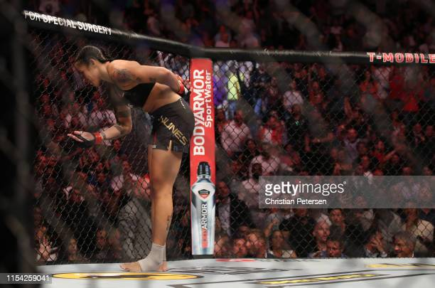 Amanda Nunes of Brazi celebrates her win over Holly Holm in their UFC bantamweight championship fight during the UFC 239 event at TMobile Arena on...