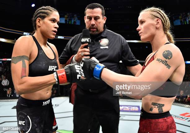 Amanda Nunes of Brazil and Valentina Shevchenko of Kyrgyzstan touch gloves in their women's bantamweight bout during the UFC 215 event inside the...