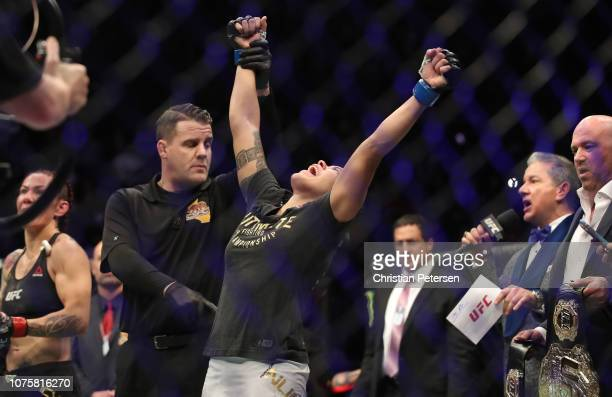 Amanda Nunes of Brazil celebrates after defeating Cris Cyborg of Brazil in their women's featherweight bout during the UFC 232 event inside The Forum...
