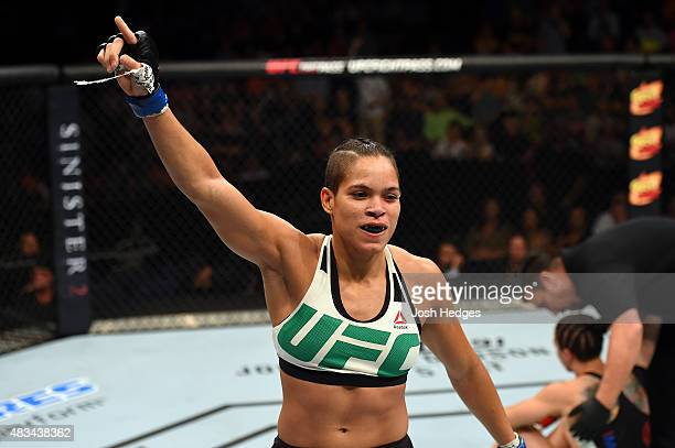 Amanda Nunes of Brazil celebrates after defeating Sara McMann in their women's bantamweight bout during the UFC Fight Night event at Bridgestone...