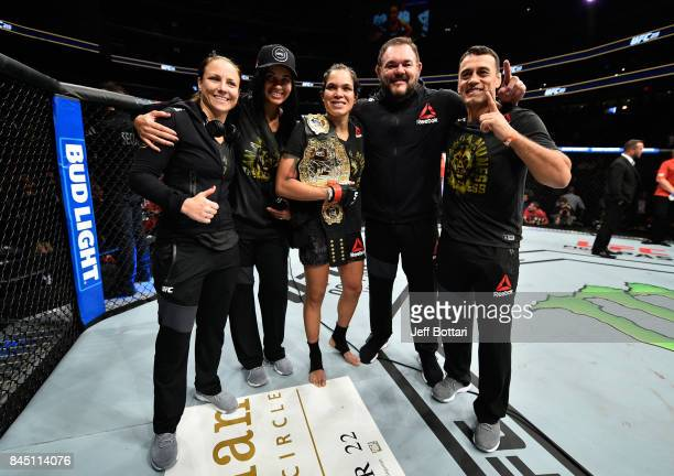 Amanda Nunes of Brazil celebrates her victory over Valentina Shevchenko of Kyrgyzstan in their women's bantamweight bout during the UFC 215 event...