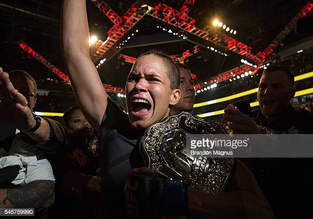Amanda Nunes of Brazil exits the Octagon after defeating Miesha Tate during the UFC 200 event on July 9 2016 at TMobile Arena in Las Vegas Nevada