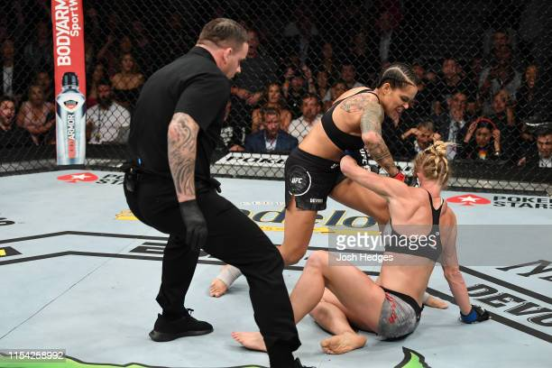 Amanda Nunes of Brazil finishes Holly Holm in their UFC bantamweight championship fight during the UFC 239 event at T-Mobile Arena on July 6, 2019 in...