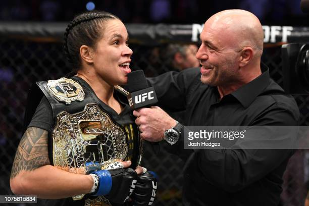 Amanda Nunes of Brazil is interviewed by Joe Rogan after her KO victory over Cris Cyborg of Brazil in their women's featherweight bout during the UFC...