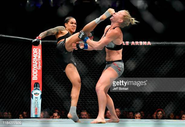 Amanda Nunes of Brazil kicks Holly Holm in the head in their UFC bantamweight championship fight during the UFC 239 event at TMobile Arena on July 7...