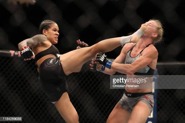 Amanda Nunes of Brazil kicks Holly Holm in their UFC bantamweight championship fight during the UFC 239 event at T-Mobile Arena on July 6, 2019 in...