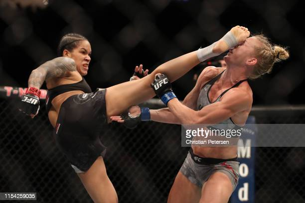 Amanda Nunes of Brazil kicks Holly Holm in their UFC bantamweight championship fight during the UFC 239 event at TMobile Arena on July 6 2019 in Las...