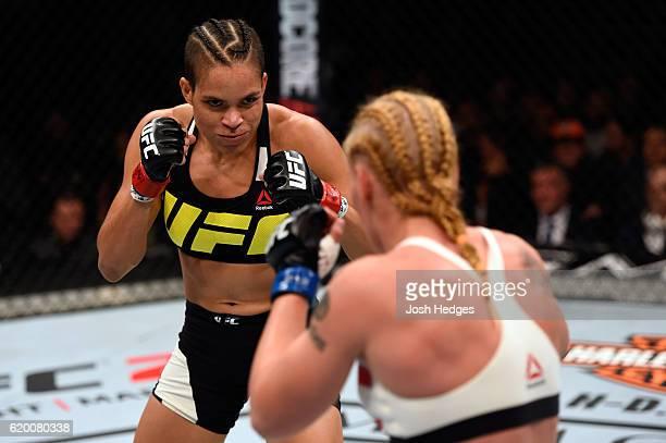 Amanda Nunes of Brazil looks to strike Valentina Schevchenko in their women's bantamweight bout during the UFC 196 event inside the MGM Grand Garden...
