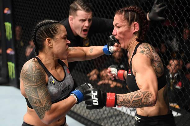 Amanda Nunes of Brazil punches Cris Cyborg