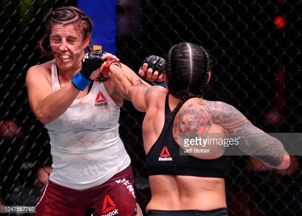 Amanda Nunes of Brazil punches Felicia Spencer of Canada in their UFC featherweight championship bout during the UFC 250 event at UFC APEX on June 06...