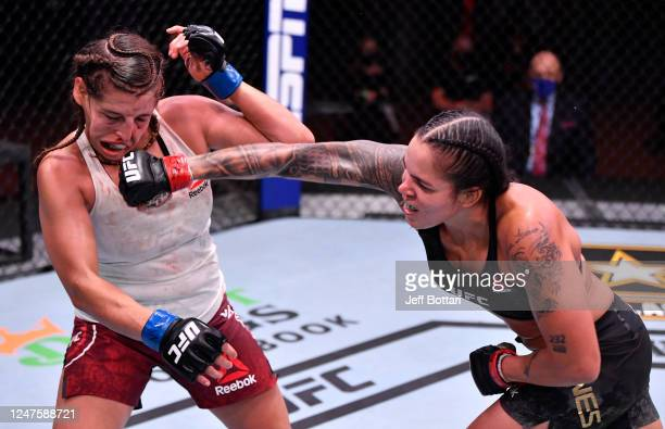 Amanda Nunes of Brazil punches Felicia Spencer of Canada in their UFC featherweight championship bout during the UFC 250 event at UFC APEX on June...