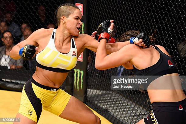 Amanda Nunes of Brazil punches Miesha Tate in their UFC women's bantamweight championship bout during the UFC 200 event at TMobile Arena on July 9...