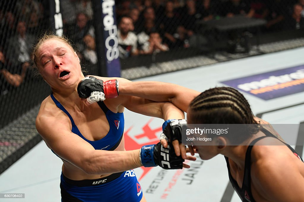 Amanda Nunes of Brazil punches Ronda Rousey in their UFC women's bantamweight championship bout during the UFC 207 event at T-Mobile Arena on December 30, 2016 in Las Vegas, Nevada.