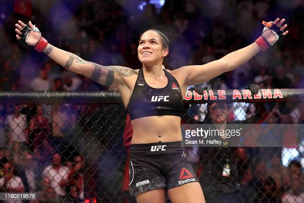 Amanda Nunes of Brazil reacts after defeating Holly Holm of the United States during their UFC Women's Bantamweight Title bout at T-Mobile Arena on...