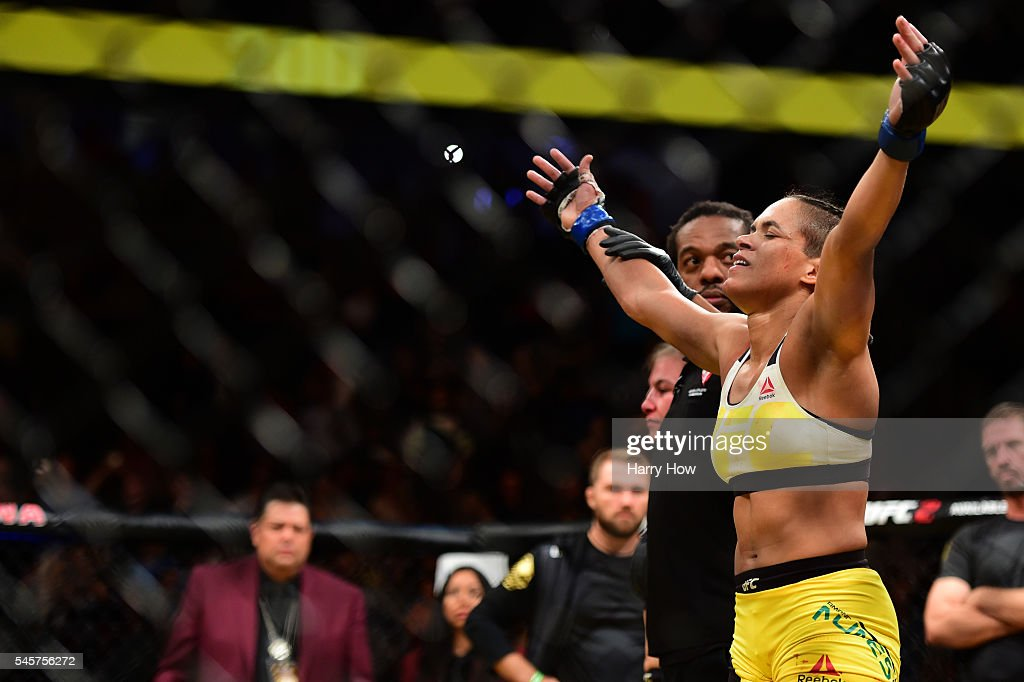 Amanda Nunes of Brazil reacts after her victory over Miesha Tate in their UFC women's bantamweight championship bout during the UFC 200 event on July 9, 2016 at T-Mobile Arena in Las Vegas, Nevada.