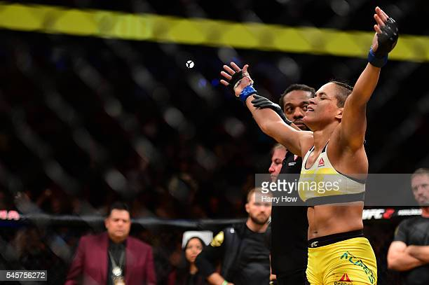 Amanda Nunes of Brazil reacts after her victory over Miesha Tate in their UFC women's bantamweight championship bout during the UFC 200 event on July...