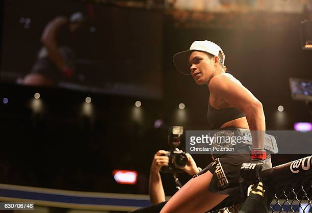 Amanda Nunes of Brazil reacts to her victory over Ronda Rousey in their UFC women's bantamweight championship bout during the UFC 207 event on...