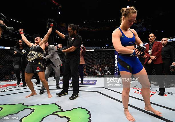 Amanda Nunes of Brazil reacts to her victory over Ronda Rousey in their UFC women's bantamweight championship bout during the UFC 207 event at...