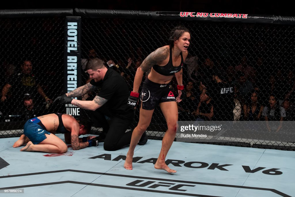 Amanda Nunes of Brazil submit Raquel Pennington of the United States in their women's bantamweight bout during the UFC 224 event at Jeunesse Arena on May 12, 2018 in Rio de Janeiro, Brazil.