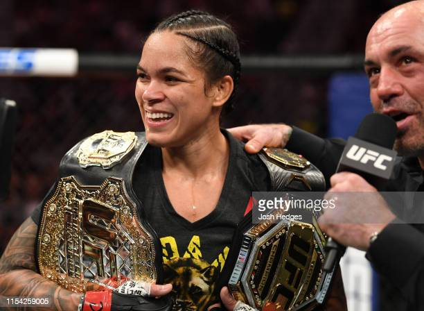 Amanda Nunes of Brazil talks with Joe Rogan following her win over Holly Holm in their UFC bantamweight championship fight during the UFC 239 event...