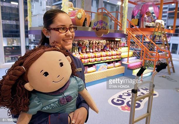 Amanda Ortiz holds a Groovy Girls doll at the upscale US toy retailer FAO Schwarz 24 November in New York The landmark Manhattan store will reopen on...