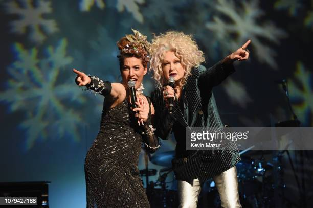 Amanda Palmer and Cyndi Lauper perform onstage during Cyndi Lauper's 8th Annual 'Home For The Holidays' Benefit Concert at Beacon Theatre on December...